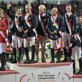 The British topped the team podium for the first time in 24 years when coming out on top at the PSI FEI European Team Jumping Championship in Herning, Denmark two years ago. This time around they will be chasing not only a back-to-back double, but also one of the three Olympic qualifying spots on offer at the FEI European Championships in Aachen, Germany. (L to R) The 2013 gold medal winning team of Scott Brash, Will Funnell, Chef d'Equipe Rob Hoekstra, Michael Whitaker and Ben Maher. (FEI/Kit Houghton)""