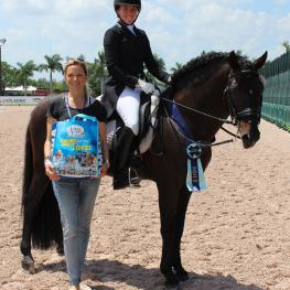 HGF Brio, ridden by Kerrigan Gluch and owned by Kim Boyer (left) of Hampton Green Farm, wins the Omega Alpha Healthy Horse Award at the Adequan Global Dressage Festival