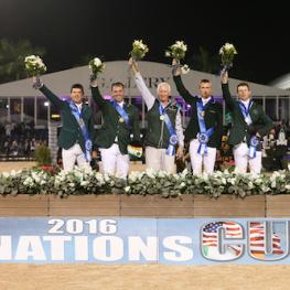 The winning Irish team of Conor Swail, Cian O'Connor, Chef d'Equipe Robert Splaine, Richie Moloney, and Shane Sweetnam with ringmaster Christian Craig.
