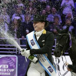 Isabell Werth celebrates her win watched by her groom Steffi Weigard and her beautiful mare Weihegold at the FEI World Cup™ Dressage Final 2017 in Omaha (USA). (Photo: Jim Hollander/FEI)