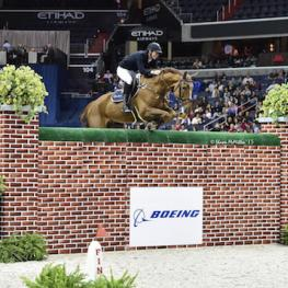 "Belgium's Jos Verlooy and Sunshine clear the Puissance wall at 2.13 meters (6'11"")"