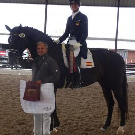 Juan Matute Jr. riding Dhannie Ymas is presented with the Custom Saddlery MVR Award at the Adequan Global Dressage Festival. Pictured with his father, dressage Olympian Juan Matute.