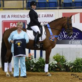 The Horse of Course was proud to sponsor Dressage at Lexington's Sporting Horse Amateur Challenge. Riding for the winning team of Donna's Divas was Kathyn Bennett on Just Georgie, who won their fourth level test with a 68.32 percent.