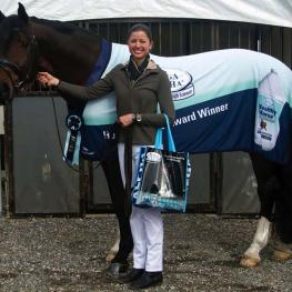 Winner Katie Poag and Zonnekoning presented with the Omega Alpha Healthy Horse Award