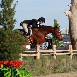 Kelley Farmer and Baltimore on their way to a $100,000 USHJA International Hunter Derby win.