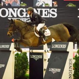 The United States' Kent Farrington repeats last year's National Horse Show victory with the win aboard Voyeur in the $250,000 Longines FEI World Cup™ Jumping Lexington.