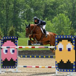 Leslie Burr Howard and Up and Blue Chapelle on their way to a $75,000 HITS Grand Prix win.