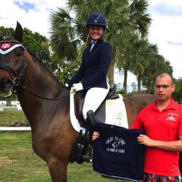 Meagan Davis and Damocles HLF win The Horse of Course High Score Award at the Welcome Back to White Fences Dressage Show