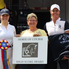 Melissa Fladland (right) wins The Horse of Course High Score Award for earning the highest score of the week with Sholitaire, presented by Beth Haist (middle) and pays the award forward to the horse's owner Makenzie Rath (left)