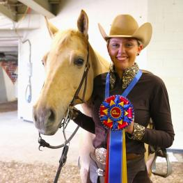 Morgan Knerr and Brie, owned by Karen Black, won the IHSA 2018 NRHA Individual Open Reining championship. (Photo: EQ Media)