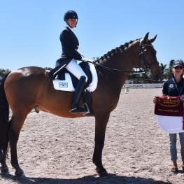 Olivia LaGoy-Weltz, riding Lonoir, wins the Custom Saddlery MVR Award at the 2017 Adequan Global Dressage Festival