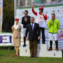 FEI World Endurance Championships for Young Horses 2015 at Valeggio Sul Mincio (ITA): gold medalist Saif Ahmed Al Mozroui (centre) was joined on the podium by Spain's silver medalist Alex Luque Moral (left) and bronze medalist Jordi Pons Serra, with (front) Manuel Bandeira De Mello, FEI Director, Endurance. (Alessandra Giorgio/FEI)