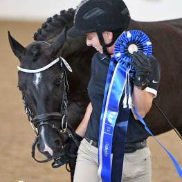 Betty Bryant and the four-year-old U.S.-bred Weser-Ems filly Ryann were awarded the NDPC Grand Championship at the 2017 National Dressage Pony Cup Championship Show's Dressage Sport Horse Breeding competition.