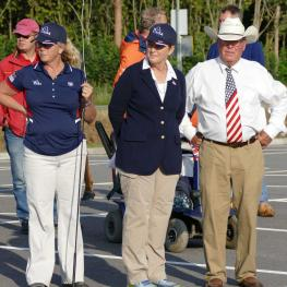 Coach Chef and Bob Giles- Team Coach Sara Schmitt, Chef d'Equipe Marcie Quist, and US Para-driving Team member Bob Giles watching the US horses during the jog.