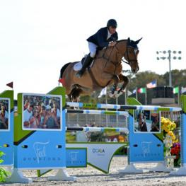 Scott Keach and Fedor on their way to a $100,000 FEI City of Ocala Grand Prix win at HITS Post Time Farm in Ocala, Florida.