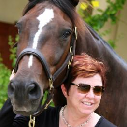 Tami Hoag with her horse at home in Palm Beach, Florida