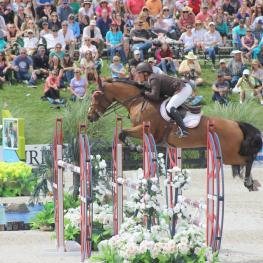 Todd Minikus and Quality Girl compete in the Great American $1 million Grand Prix at HITS Horse Show in Ocala, Fl