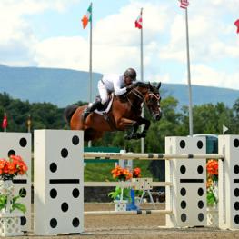 Todd Minikus and Quality Girl on their way to a $75,000 UlcerGuard Grand Prix win.