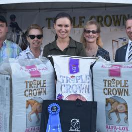 Olympic rider Adrienne Lyle was awarded with bags of Alfa-Lox™ Forage from Triple Crown® Nutrition at the AGDF FEI Jog. (Left to Right: Triple Crown FL rep Craig Bernstein, Show Chic owner Michele Hundt, Olympic rider Adrienne Lyle, show manager Noreen O'Sullivan and judge Lee Tubman).