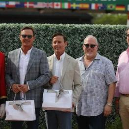 Ken Berkley (leading hunter trainer) and Scott Stewart (leading hunter rider) accept their awards with ringmaster Steve Rector; Stuart Winston, Chief Marketing Officer & Executive Director of Retail; and Craig Dickmann, Director