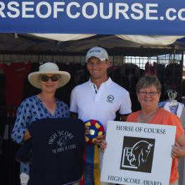 Beth Haist (right) of The Horse of Course presents rider Benjamin Pfabe (center) and owner Jackie Nixon-Fulton (left) with The Horse of Course High Score Award