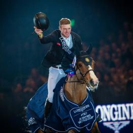 Great Britain's William Whitaker posted the biggest win of his career when galloping to victory with Utamaro d'Ecaussines in today's Longines FEI Jumping World Cup™ 2018/2019 Western European League qualifier at Olympia in London (GBR). (FEI/Jon Stroud)