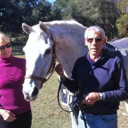 Anne and Davis Gribbons with her Olympic horse Metallic