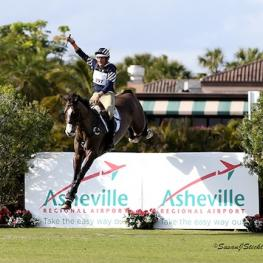 Boyd Martin and Trading Aces landing from the final cross-country jump for victory. Photo copyright SusanJStickle.com