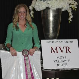 Canadian dressage rider Brittany Fraser accepts the Custom Saddlery Most Valuable Rider (MVR) Award at the 2015 Adequan Global Dressage Festival