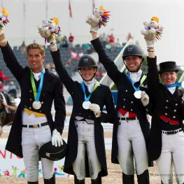 The Canadian 2015 Pan American Games Dressage Team claims the Silver medal. From left to right: Chris von Martels, Brittany Fraser, Megan Lane, and Belinda Trussell. Photo courtesy of Cealy Tetley