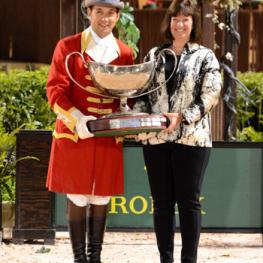 Carlene Ziegler accepts the Harrison Cup Perpetual Trophy on behalf of Artisan Farms at the 2015 Winter Equestrian Festival in Wellington, FL.  Photo by Starting Gate Communications