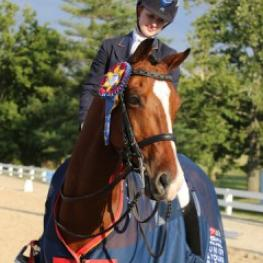 NAJYRC Gold medalist Catherine Chamberlain, bolstered by the Renee Isler Fund is managing Renee Isler Dressage Scholarship Silent Auction On Facebook