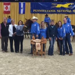 Feaser and Lil' Red accept their first place prize of a saddle donated by Cowboy Classics Saddlery. (c) A Home for Every Horse