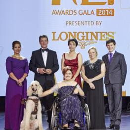 "Equestrian heroes were celebrated tonight at the glittering FEI Awards 2014, the ""Oscars of the equestrian world"", presented by Longines in Baku's fabulous Buta Palace (left to right): HRH Princess Haya, Jeroen Dubbeldam (NED), Melissa Tan (SIN) chairman of equine therapy centre Equal Ark, Jackie Potts (GBR), Lambert Leclezio (MRI) with (centre) Sydney Collier (USA) and her service dog Journey. (FEI/Liz Gregg)"