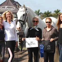 Janne Rumbough and Junior receive the ShowChic Turnout Award at the 2015 Adequan Global Dressage Festival (left to right: Kastel Denmark's sponsored rider Lauren Knopp, Charlotte Jorst of Kastel Denmark, Janne Rumbough, Michele Hundt of ShowChic, and Krystalann Shingler of ShowChic)