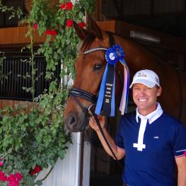John Zopatti and Uwannabeme WH (Slim) celebrate winning the Third Level Open Championship at the May Day Dressage Qualifier One in Jacksonville, Florida