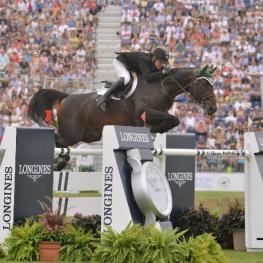 Kevin Babington and Shorapur jumped to the top of the $250,000 Hampton Classic Grand Prix, presented by Land Rover. (Shawn McMillen photo)