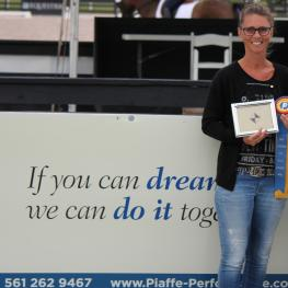 Maiken Englebrecht Thomsen (left) is awarded the Piaffe Performance Adult Amateur Achievement Award by Katie Riley of Piaffe Performance (right) at the 2015 Adequan Global Dressage Festival