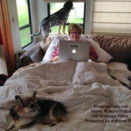 Sue Weakley enjoying the working conditions in the HorsesDaily RV at the Kentucky Horse Park during the US Dressage Finals. Bird is always on guard, and Tasha always provides comfort.