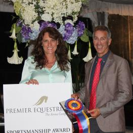 Heidi Zorn of Premier Equestrian presenting Olympian and US Dressage Team chef d'equipe Robert Dover with the Premier Equestrian Sportsmanship Award during the 2014 Global Dressage Festival.