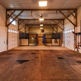 Beautiful four stall barn with Radiant heated floors