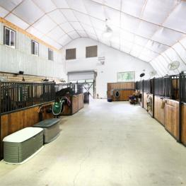 Stall Barn Aisle Looking Into Arena