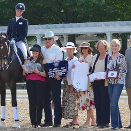 Sabine Schut-Kery rode Sanceo to the Prix St. Georges Championship. Pictured with owners Alice Womble-Heitmann and Dr. Mike Heitmann, ground jury members Jane Weatherwax, Sandy Hotz, Christel Carlson and Markel representatives Lisa and John Seger.