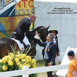 Steffen Peters and Robert Dover rejoice in his Gold Medal ride. Photo: © Diana De Rosa
