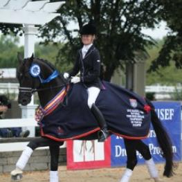 Alice Tarjan (Oldwick, NJ) and her own Somer Hit (Sandro Hit-Rhussia by Rotspun) proved to be at the top of the class of the 11 horse field in the 2012 Six-Year-Old Championship