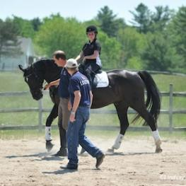 Kai Handt and Wes Dunham showcase collaborative coaching at the Northeast Symposium in 2013. Rider Sydney Collier aboard her own Wentworth works on gaits. (Photo (C) Lindsay Y. McCall)