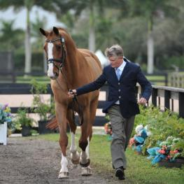 U.S. Chef D' Equipe Kai Handt jogs Rubicon 75, ridden by Mary Jordan, owned by Vinceremos Therapeutic Riding Center (Photo (c) Lindsay Y. McCall)