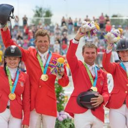 USA's Marilyn Little, Boyd Martin, Phillip Dutton and Lauren Kieffer celebrate team Jumping gold at the Pan-American Games in Caledon Park, Toronto, Canada today. (Photo: Diana DeRosa)