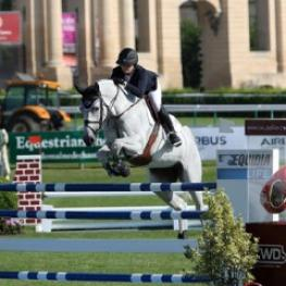 2014 Artisan Farms Young Rider Grand Prix Series winner Victoria Colvin of the United States guides Cesanna to victory in the CSI2* Global Champions Tour 1.35m speed competition in Chantilly, France. Photo by Sportfot