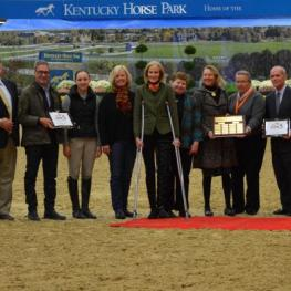 Awards presented to 2014 Zone 5 Horseman of the Year, the Kentucky Horse Park Foundation and Mindy Darst. Pictured (Left to right) Maria Holt, Patrick Boyle, Greg Darst, Maddy Darst, Patti Rogers, Lulu Thomas, Laura Crum, Nina Bonnie, Diane Carney, Bill Maroney and John Darst. Photo by Chicago Equestrian.